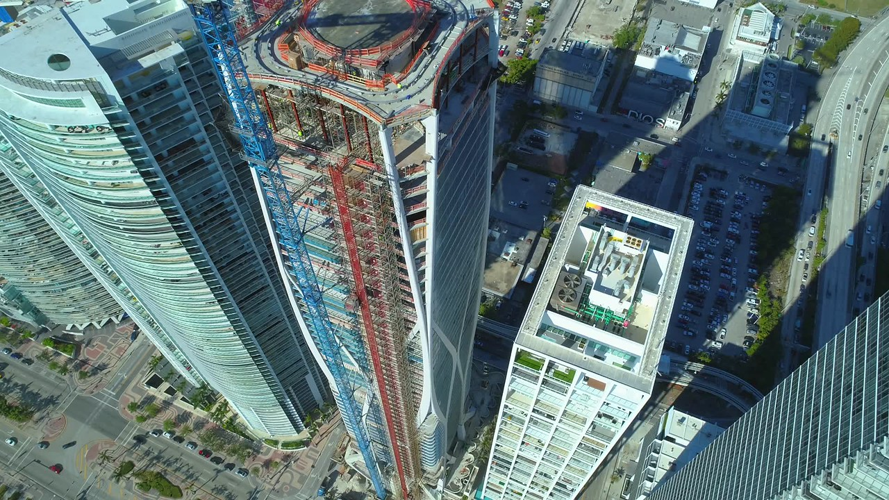 Drone aerial video highrise buildings rooftops 4k 60p
