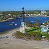 Aerial orbit shot Hillsboro Inlet Lighthouse Pompano Beach FL 4k 60p