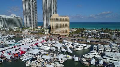 Sideways aerial drone video Miami International boat show 4k