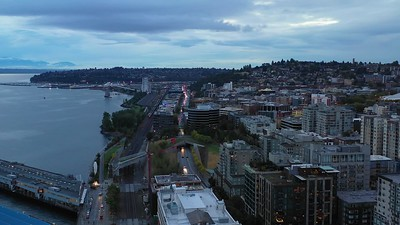 Seattle aerial drone footage bay train tracks mountain landscape