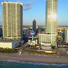 Aerial Hallandale Beach water tower approach reveal tilt down 4k 24p
