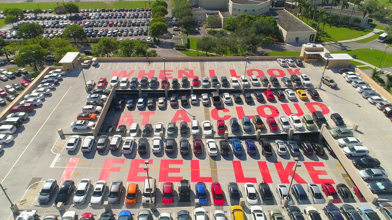 FIU student parking lot rooftop writing message
