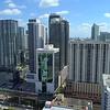 Aerial stock Downtown Miami Brickell and metro rail line 4k