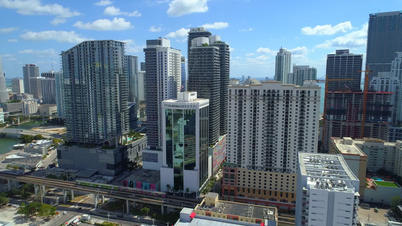 Aerial stock Downtown Miami Brickell and metro rail line 4k