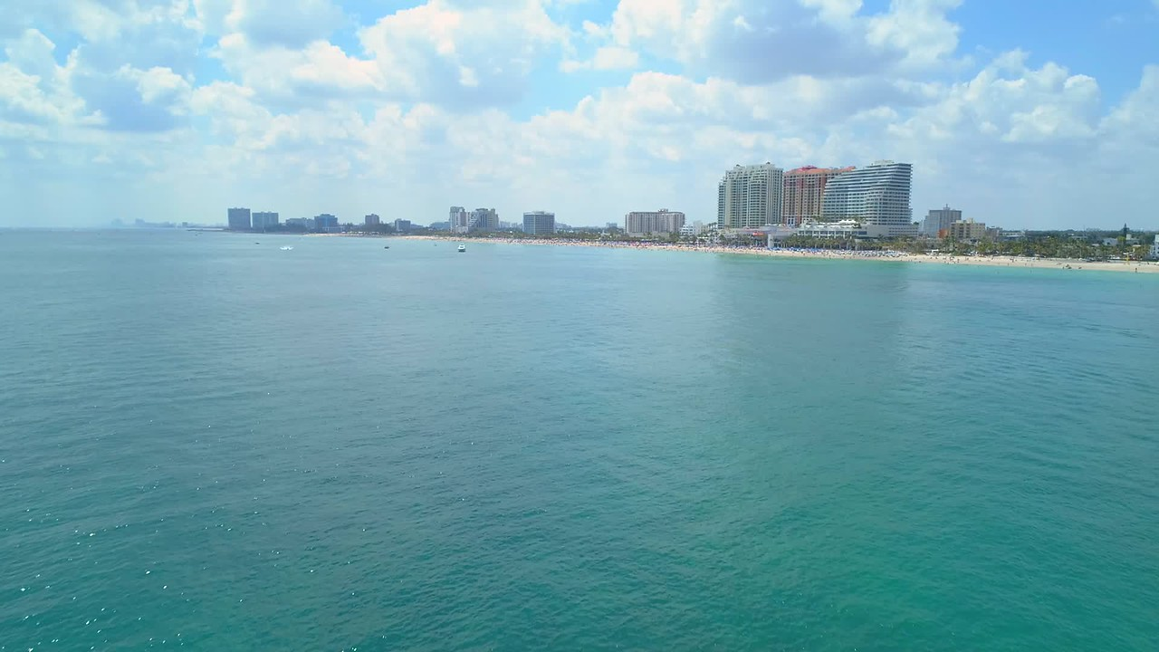 Aerial drone approach reveal flyover Fort Lauderdale beach Florida 4k 60p