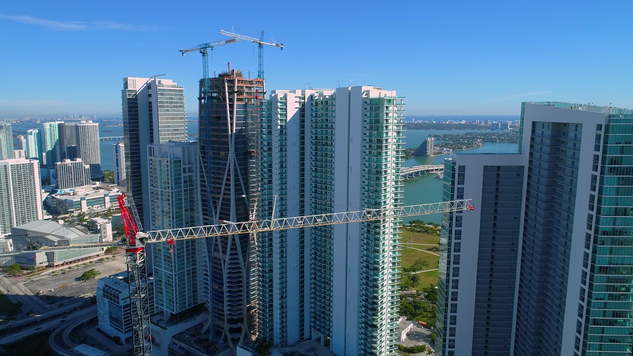 Aerial reveal Downtown Miami FL skyscrapers  and cranes 4k 24p
