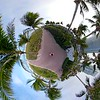 Miniature planet motion footage Miami Beach ocean walkway