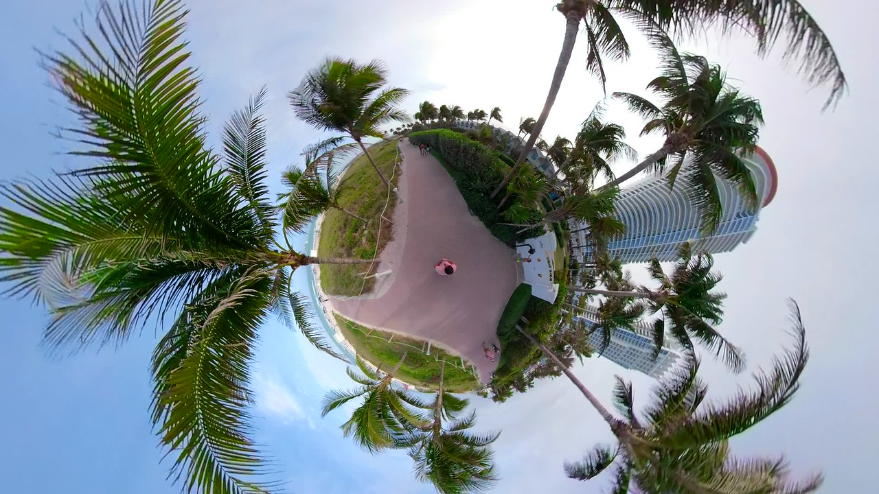 Miniature planet motion footage Miami Beach ocean walkway