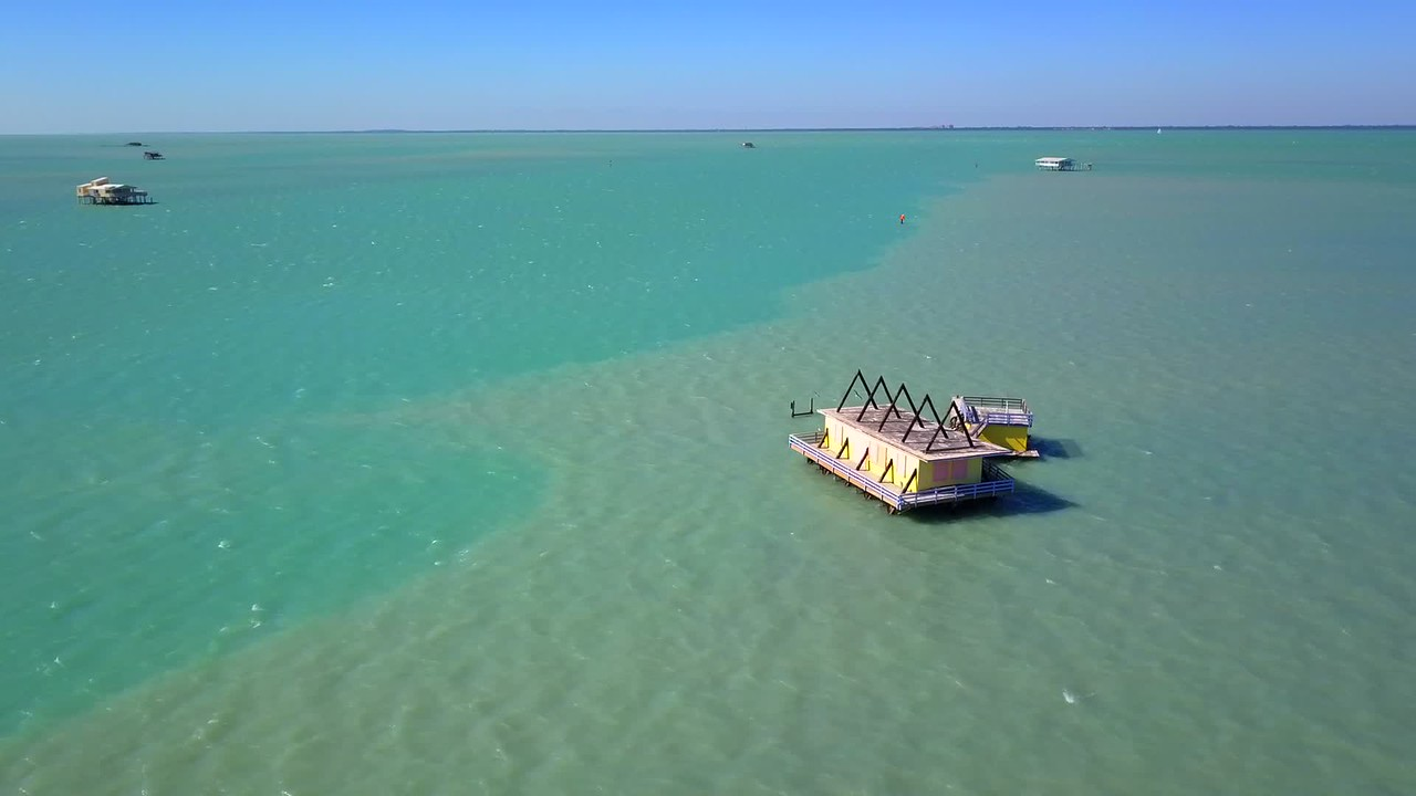 Aerial video Stiltsville wood stilt houses Biscayne Bay Miami Florida 4k 24p