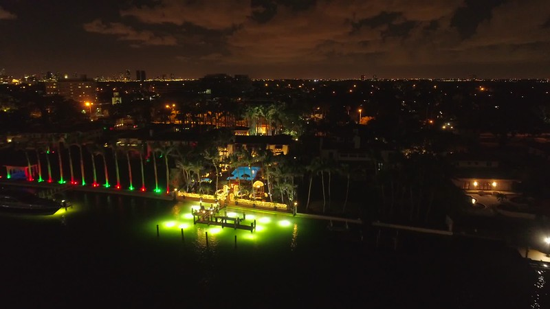 Luxury mansion at night aeria ldrone flyover