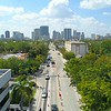 Drone footage Las Olas Boulevard approaching Downtown city 4k 60p