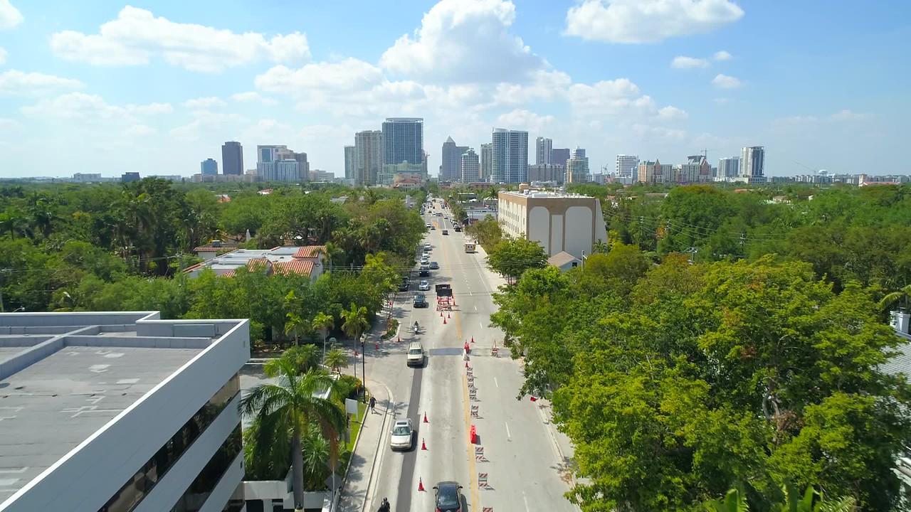 Drone footage Las Olas Boulevard approaching Downtown city 4k 60p