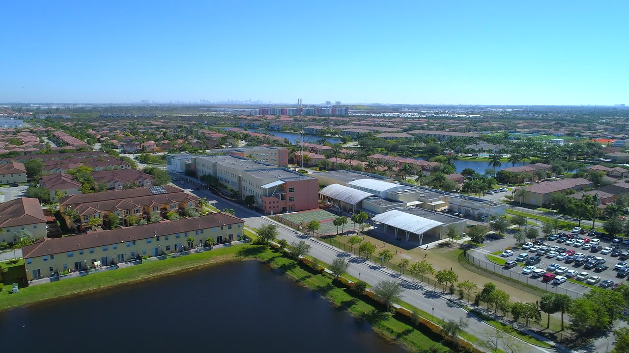 Stock aerial video Doral Miami Dade Florida residential homes and school