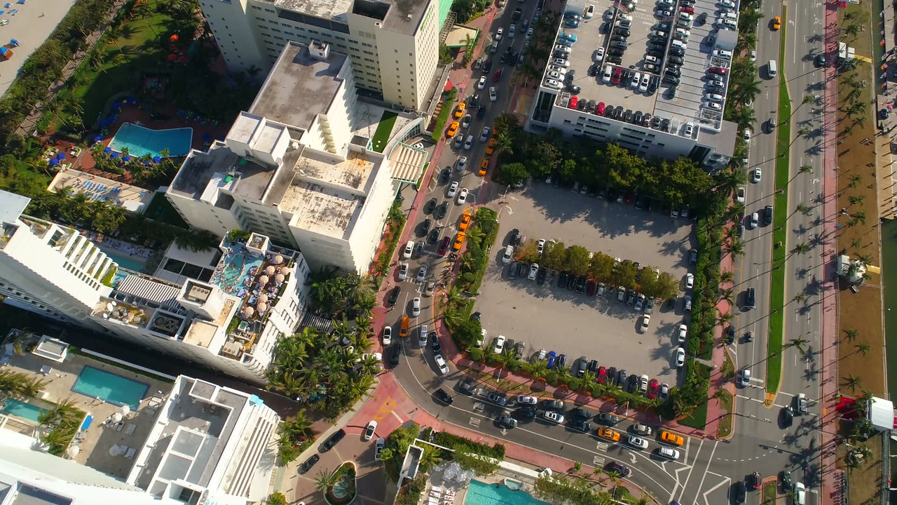 Aerial pull away reveal footage Miami Beach Fontaineblea Hotel