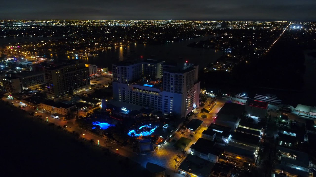 Slow aerial night orbit Hollywood Margaritaville Resort