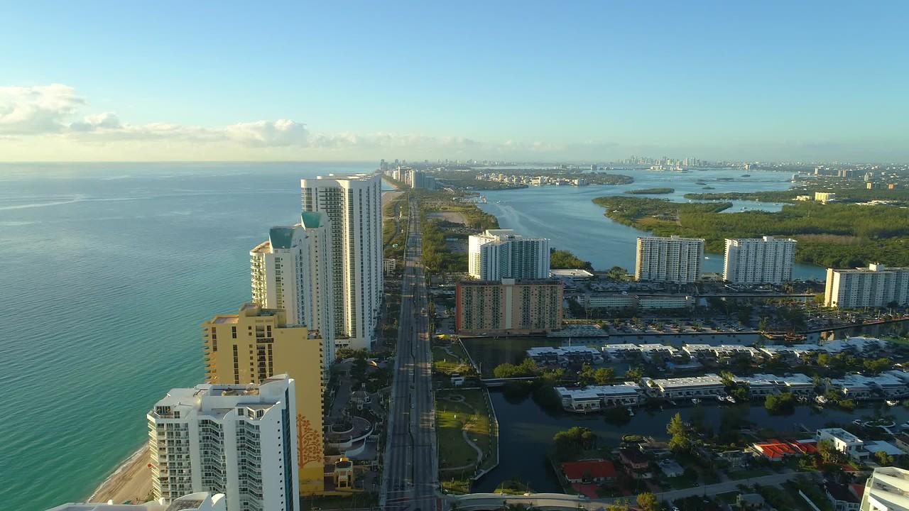 Aerial forward slow motion video highrise condominiums Sunny Isles Beach FL