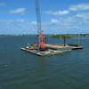 Construction barge on water with a crane 4k active tracking orbit shot