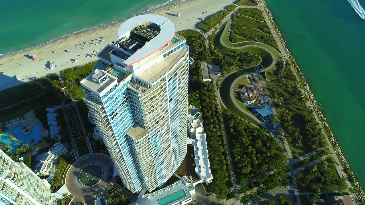 Aerial Continuum Miami Beach rooftop flyover camera tilt down