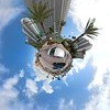 Driving Collins Avenue Tiny planet with super tall skyscrapers