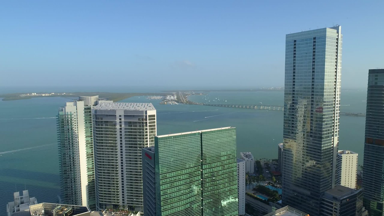 Aerial drone footage Brickell Arch rooftop flyover tilt down 4k 60p