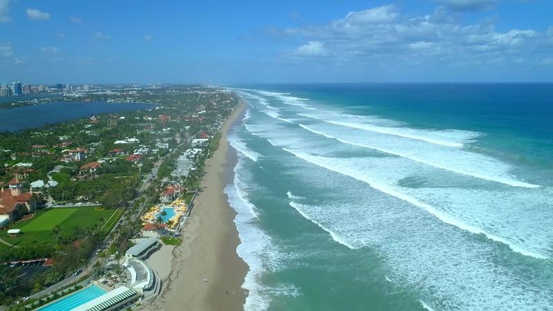 Aerial pull out away shot Mar a lago Palm Beach compound beachfront resort