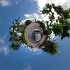 Car driving on a road with trees tiny mini planet