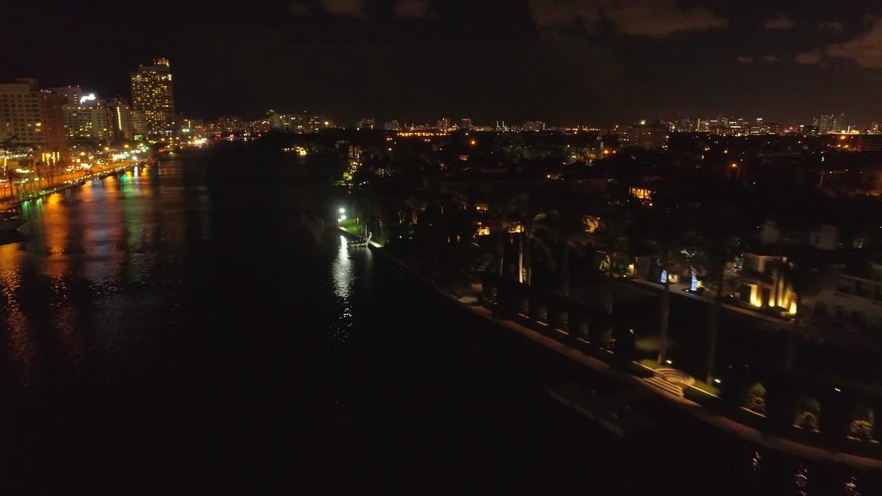 Aerial night footage luxury homes in Miami Beach FL