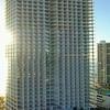 Bright morning sun and Florida condominiums on the ocean 4k 24p