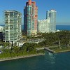 Aerial establishing drone video Miami Beach waterfront condominiums flyover tilt down