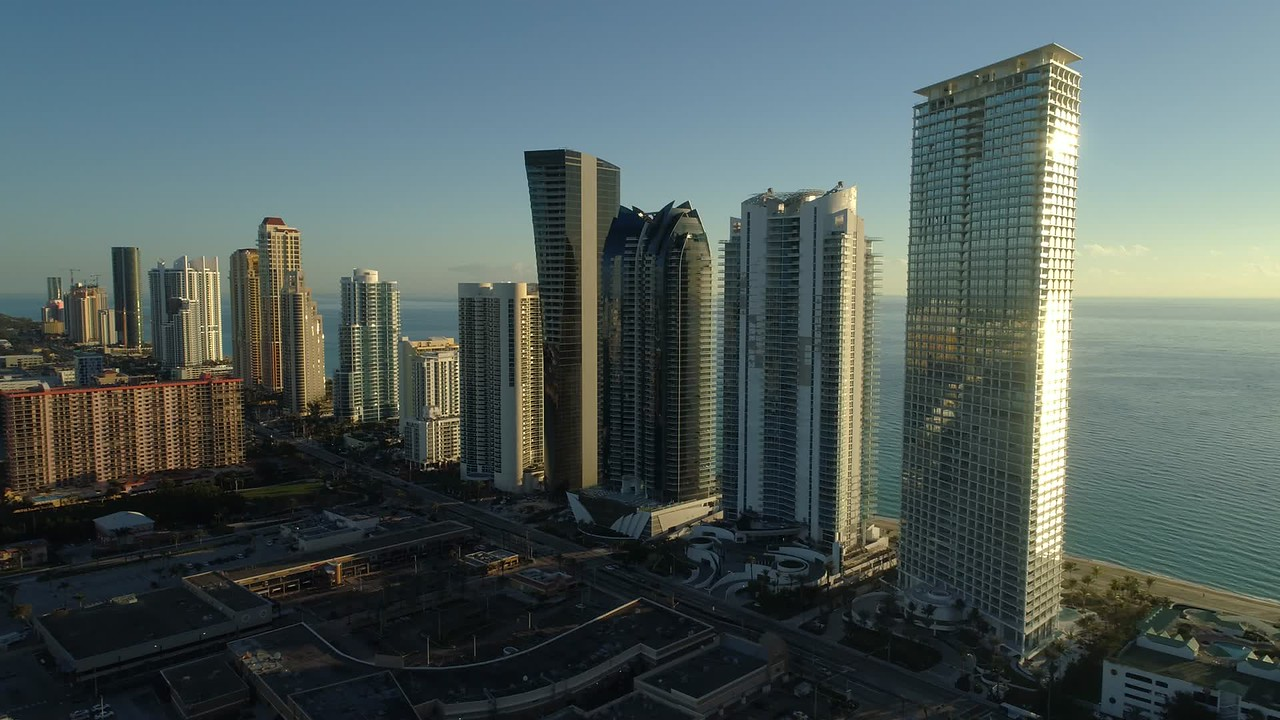 Stock aerial establishing shot Sunny Isles Beach Florida 4k