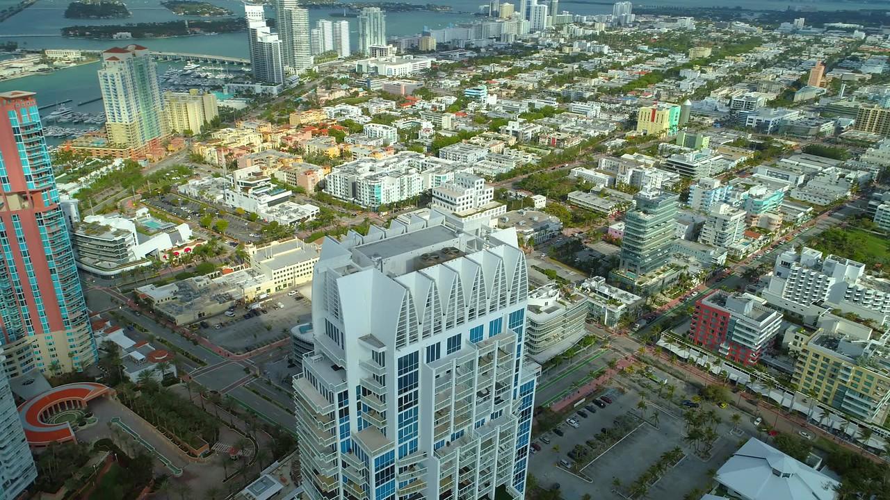 Aerial roof orbit highrise skyscraper Miami Beach Continuum 4k