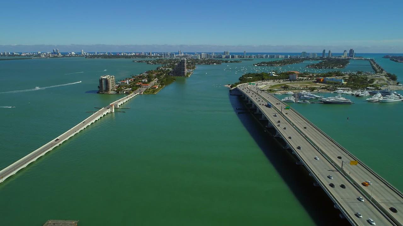 Aerial Miami Biscayne Bay Macarthur Venetian causeway establishing shot 4k 24p