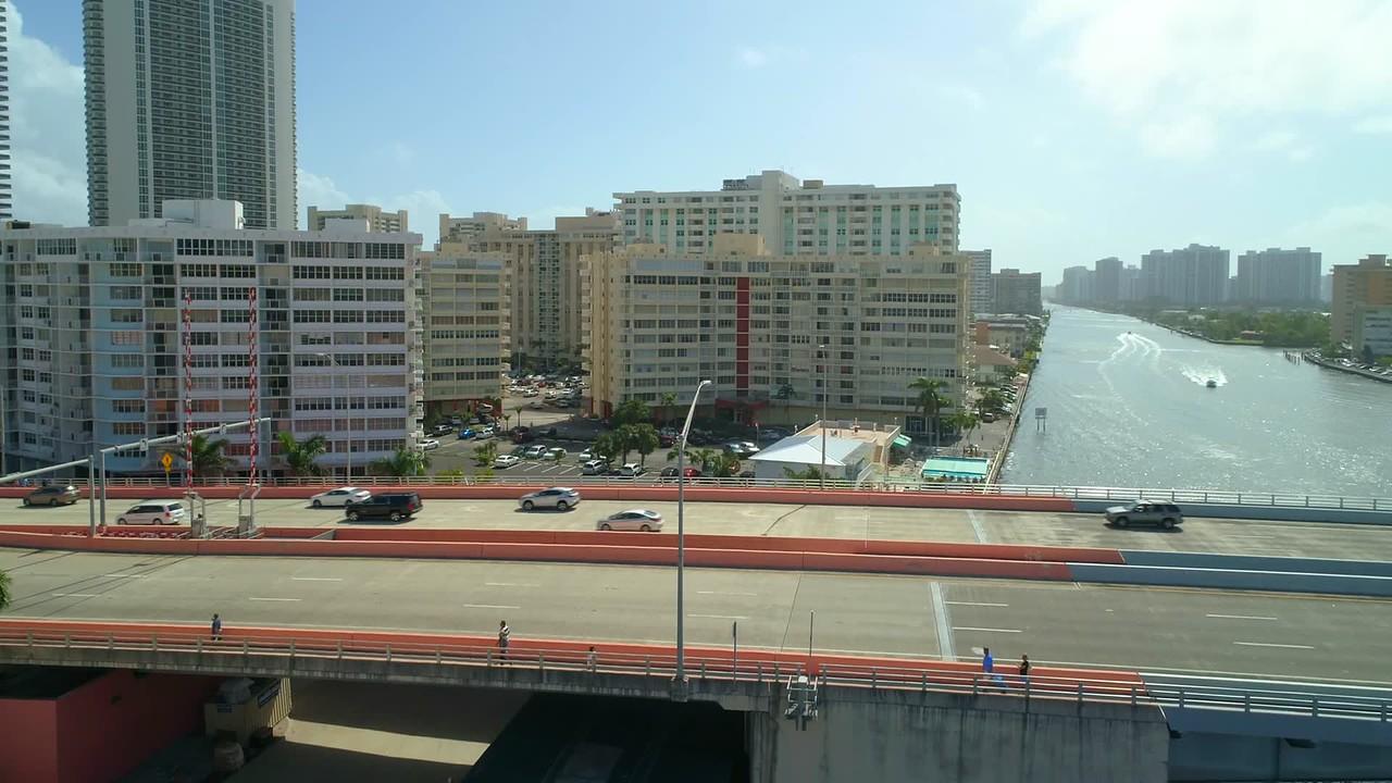 Cinematic aerial flyover Hallandale Beach Florida construction sites