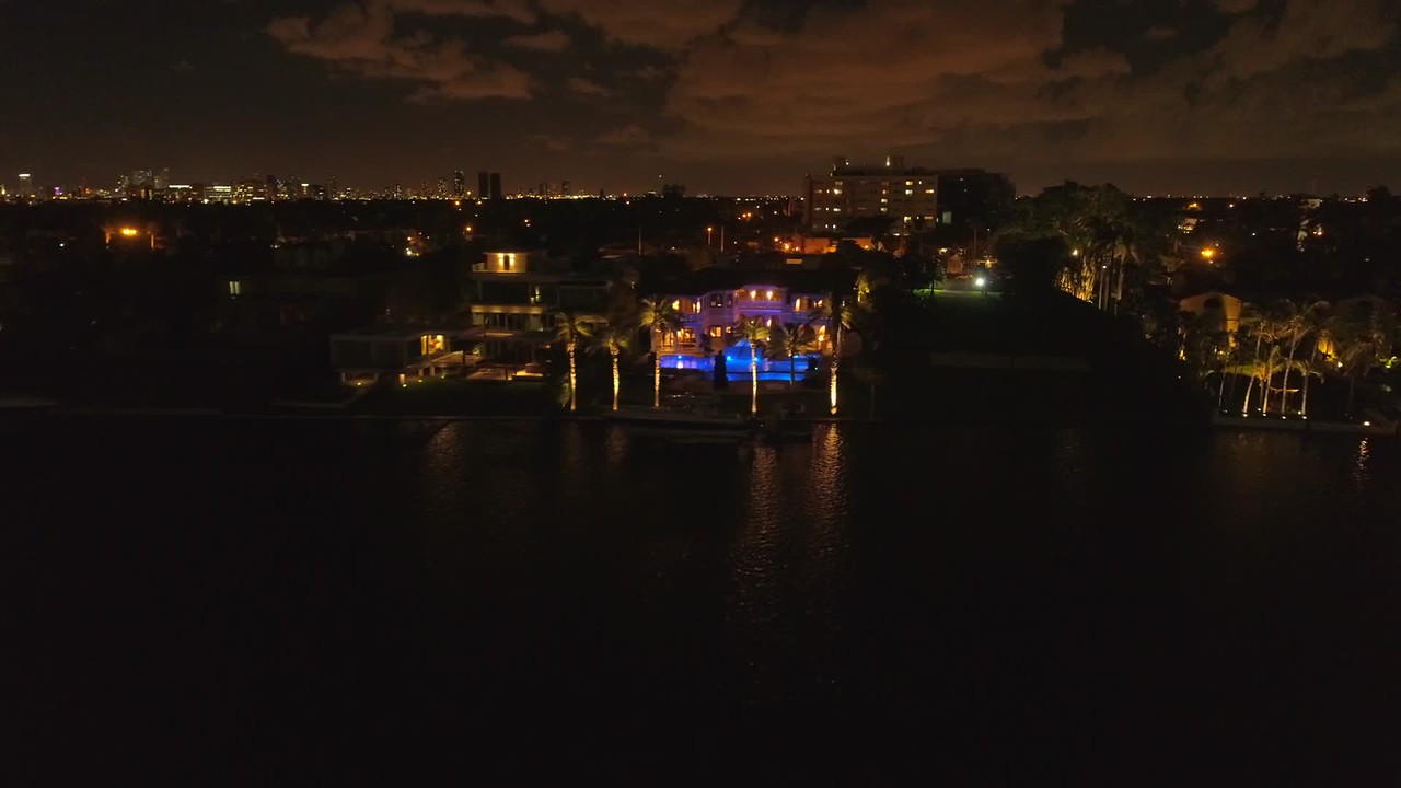Movie footage of a Miami Beach mansion at night