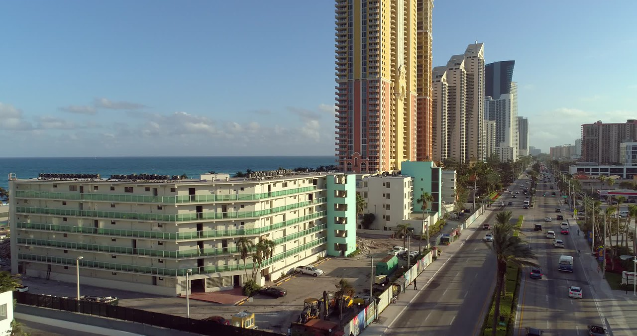 Aerial drone footage Sunny Isles Beach Golden Strand Ocean Villa Resort demolition site