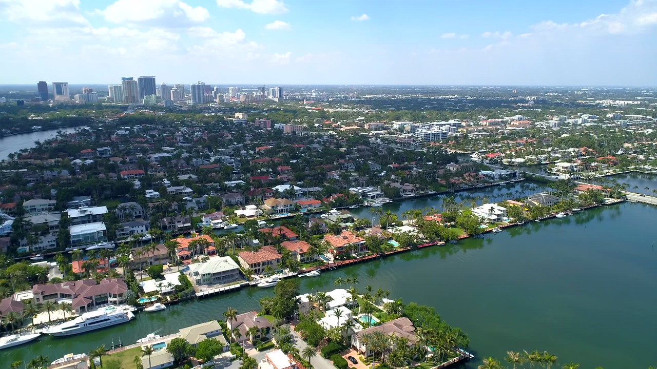 Aerial footage Las Olas Isles residential mansions with view of Downtown in distance