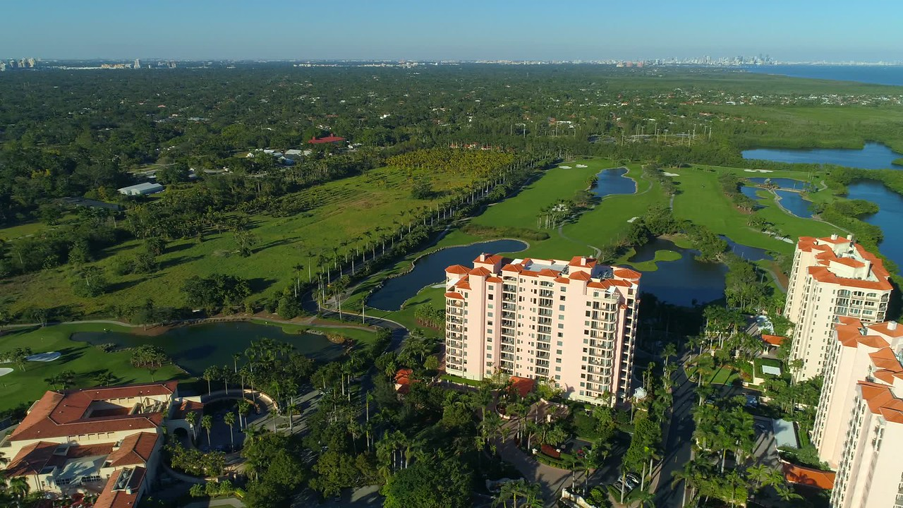 Aerial footage upscale condominiums golf course and yachts Miami Florida