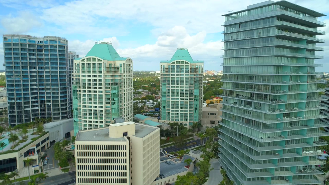 Aerial drone video upscale condominiums Coconut Grove Miami Florida 4k 60p