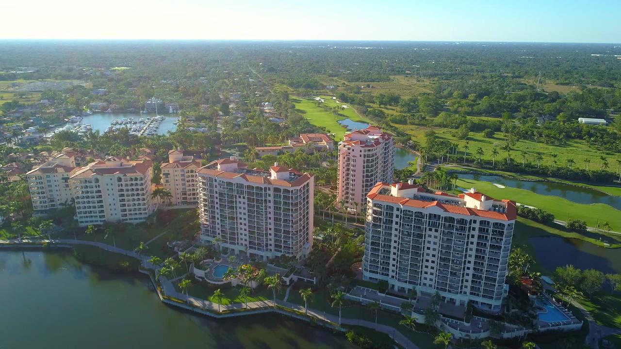 Aerial flyover and tilt down luxury buildings residential condominiums 4k