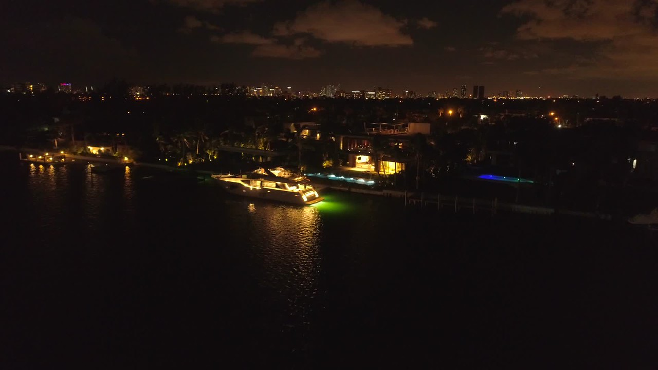 Luxury Miami Beach yachts and mansions at night