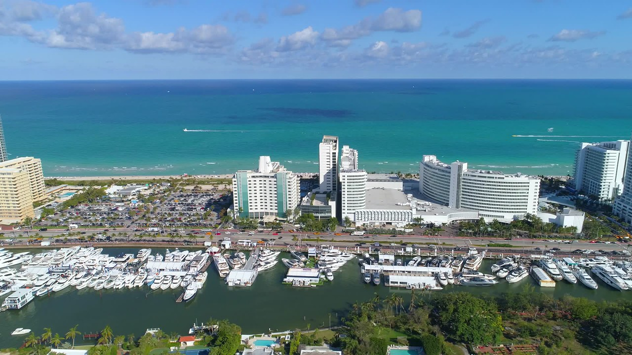 Aerial hyperlapse miami video mansions yachts hotels and Atlantic Ocean
