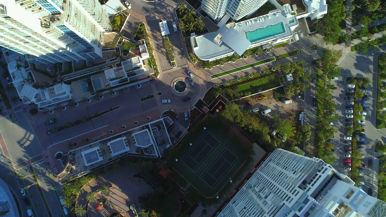 Aerial rooftop flyover Continuum Towers South Beach Miami 4k