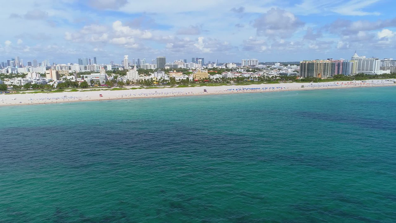 Fast aerial approach Miami Beach Ocean Drive south