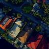 Aerial facing down neighborhood homes tilt up reveal yachts Fort Lauderdale FL