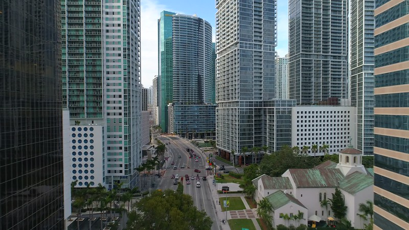 Aerial above Brickell Bay river bridge avenue 4k 24p