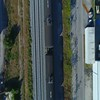 Drone flying directly over a moving train 4k 24p