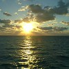 Aerial drone lateral motion footage morning sunrise over ocean 4k 60p