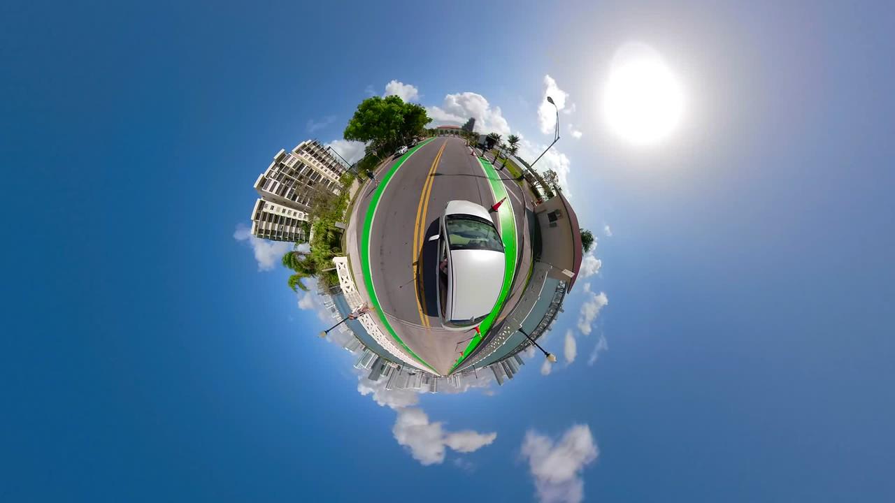Tiny planet Venetian Causeway driving through toll road