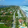 Beautiful aerial tour Palm Beach Florida oceanfront luxury real estate mansion homes and waves