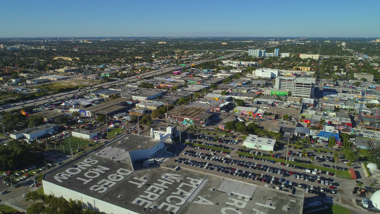 Aerial hyperlapse sped up video Miami highway and Wynwood city
